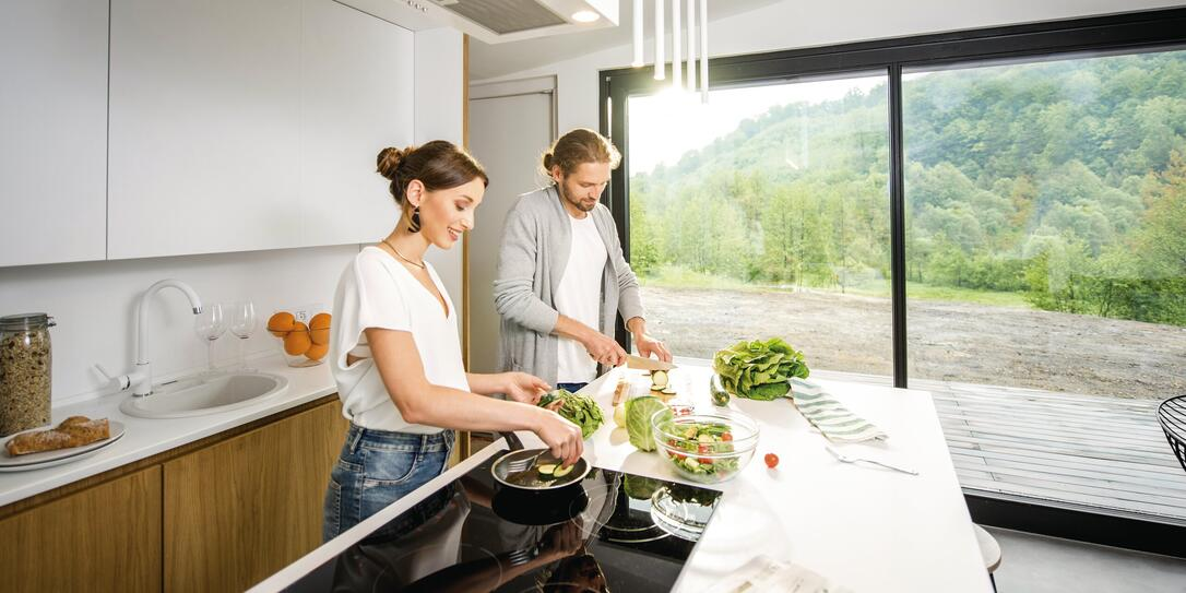 Couple cooking food at the kitchen home