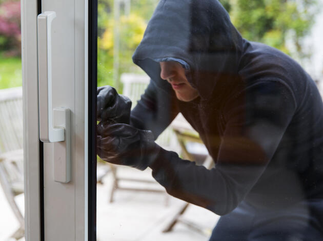 Burglar using special tools to break in  a house