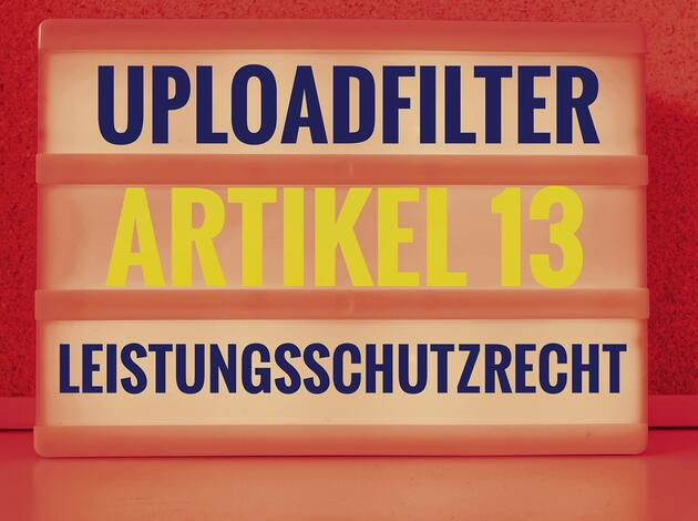 Illuminated panel with the german words Uploadfilter Artikel 13 Leistungsschutzrecht in english Upload filter Article 13 ancillary copyright