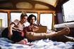 Couple watching movie on tablet in motor home