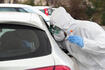 Italy, coronavirus test drive-through, directly in the car